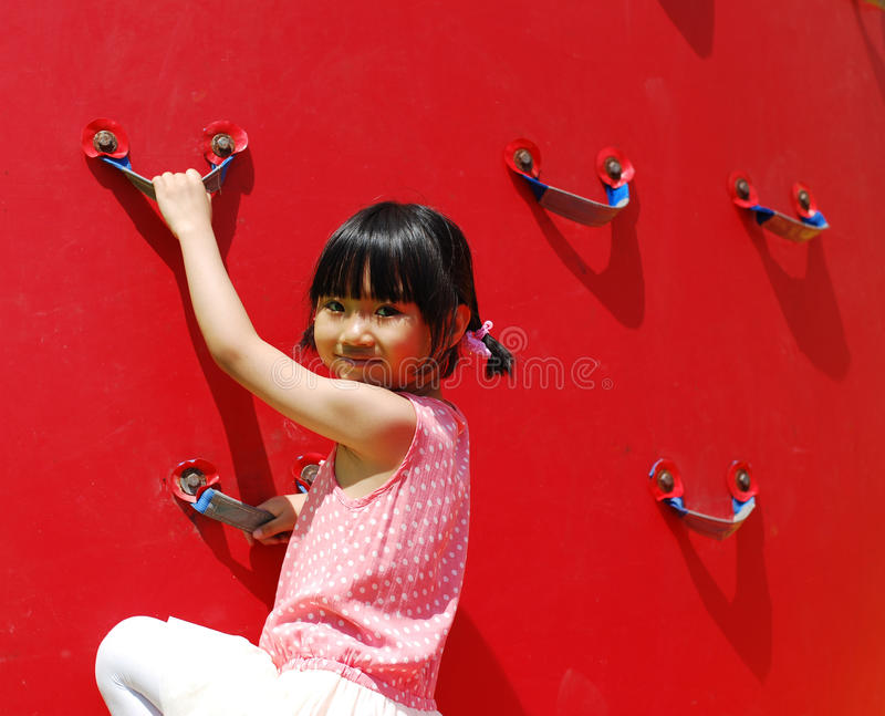 Asian little girl playing stock photos