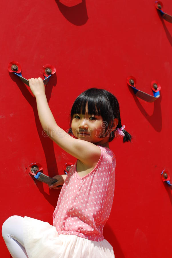 Asian little girl playing stock photo