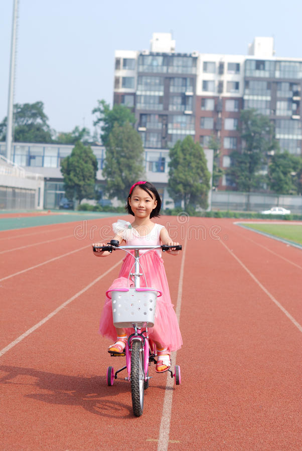 Download Asian Little Girl Riding A Bicycle Stock Image - Image: 26882661