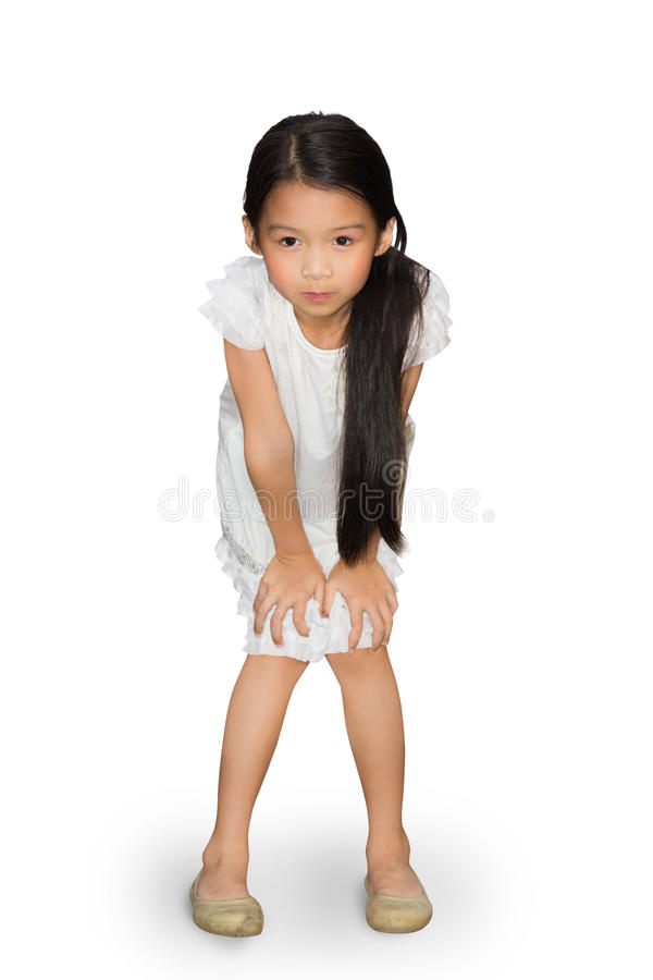Asian little girl standing with hands on knees. Over white with clipping path royalty free stock photo