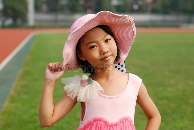 Asian little girl wear straw hat royalty free stock image