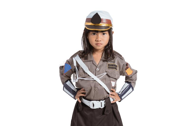 Asian little girl wearing a police uniform with two hands on her waist stock images