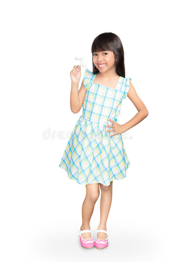Asian little girl with white frangipani flower in her hand royalty free stock images