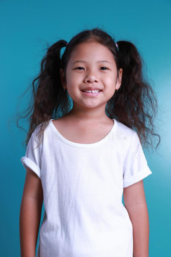 Free Asian Little Kid Girl Smile Happiness Portrait Looking At The Camera On Green Background Royalty Free Stock Photos - 194061578
