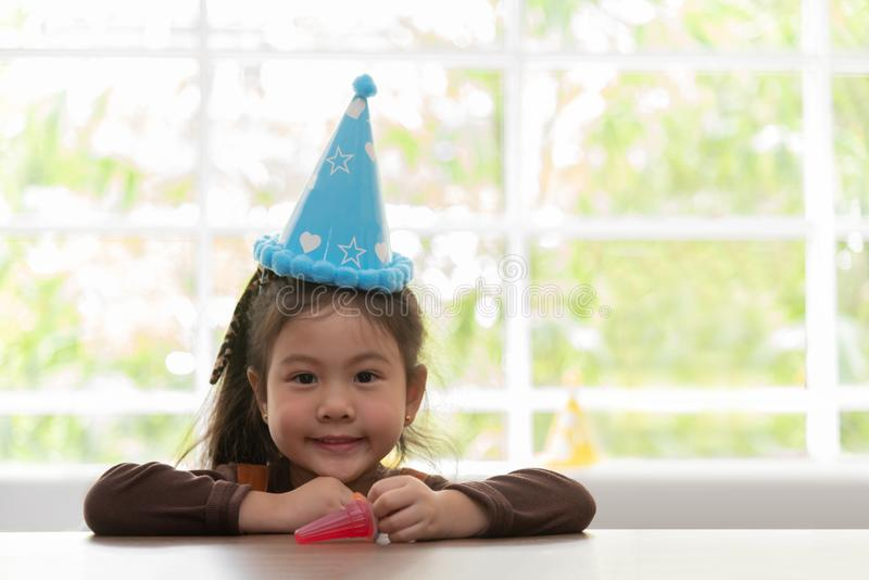 Asian Little Kid girl wear birthday hat is smiling. Copy space royalty free stock photos