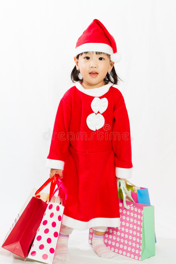 Asian Little Santa Claus with shopping bag royalty free stock images