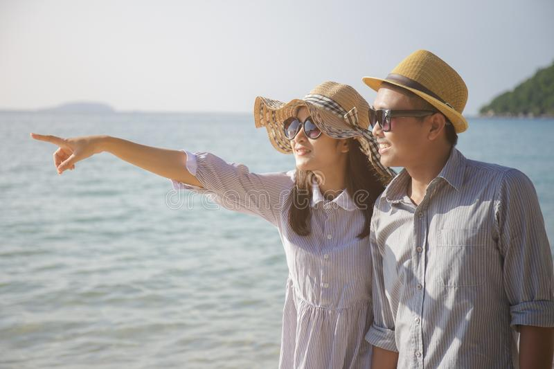 Asian love couple travel on the sea in summer season royalty free stock photos
