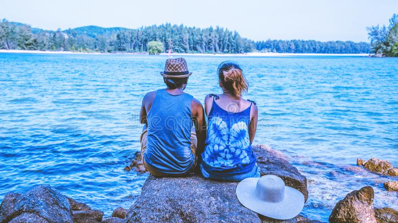 Asian lover woman and man travel nature. Travel relax. On the rocks at the sea. In the summer. Thailand. Asian lover women and men travel nature. Travel relax royalty free stock images