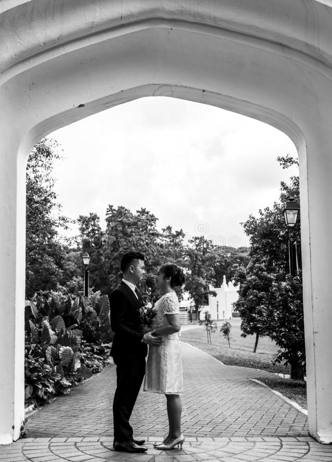 Black and White photo. Asian loving couple pre-wedding outdoor photo shoot. Casual natural real people portraits. stock photos
