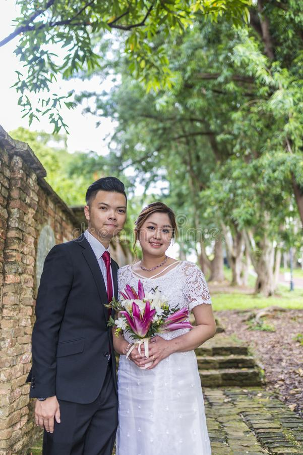 Asian loving couple pre-wedding outdoor photo shoot. Casual natural real people portraits. royalty free stock images