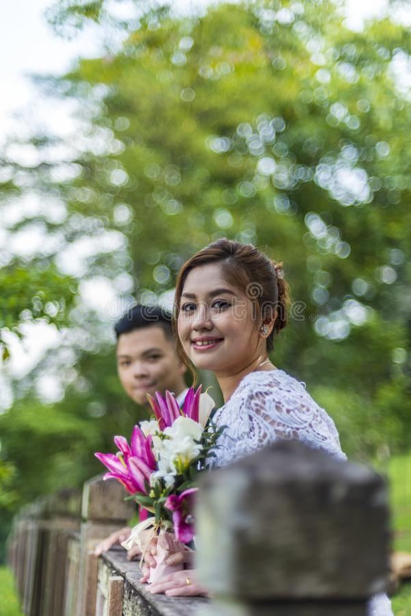 Asian loving couple pre-wedding outdoor photo shoot. Casual natural real people portraits. Loving romantic couple royalty free stock photos