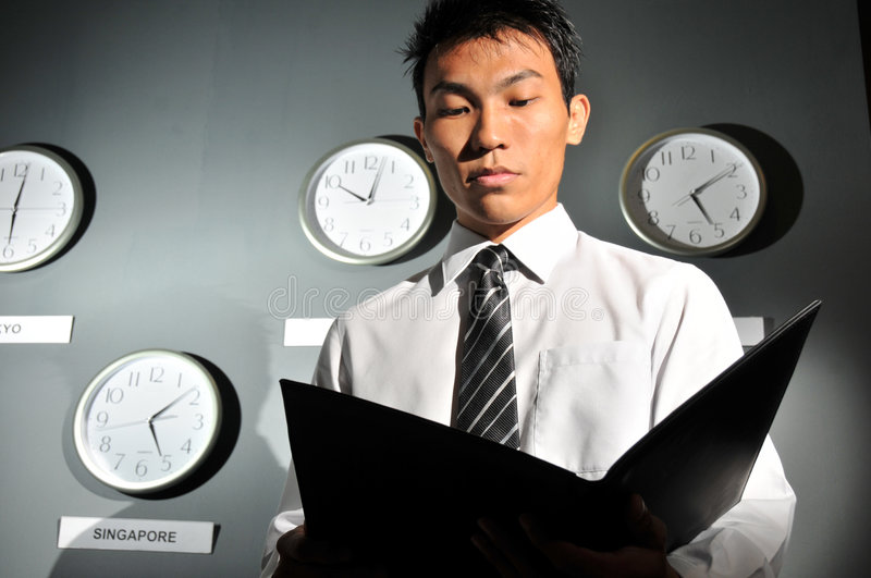 Download Asian Male Boss Scrutinizing Office Work Stock Photo - Image: 7139498
