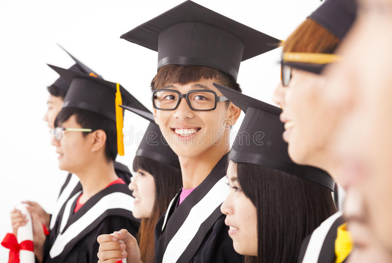 Asian male college graduate at graduation stock photography