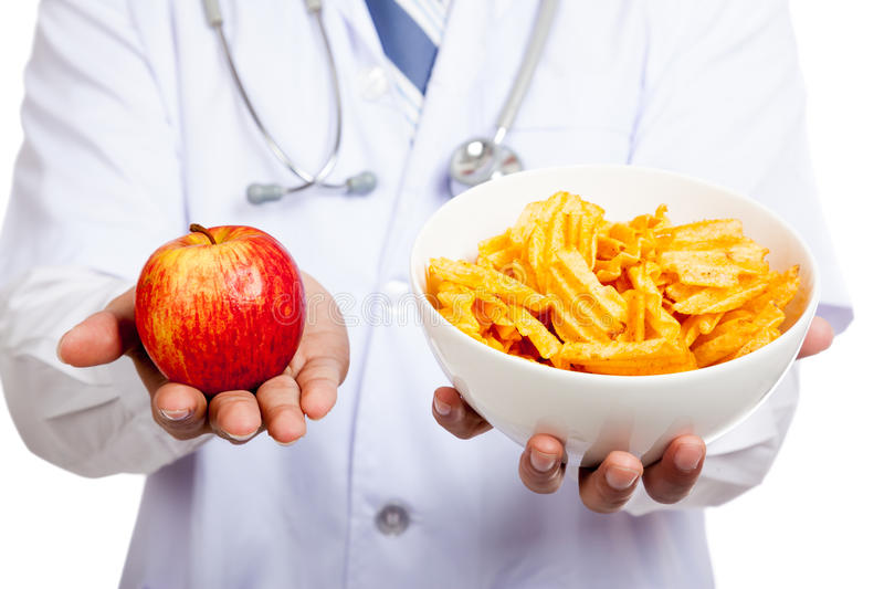 Download Asian Male Doctor With Red Apple And Potato Chips Stock Image - Image of potato, healthy: 46651329