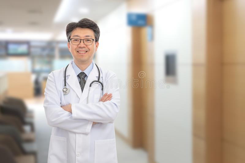 Asian male doctor smiling in the background of the hospital stock photos