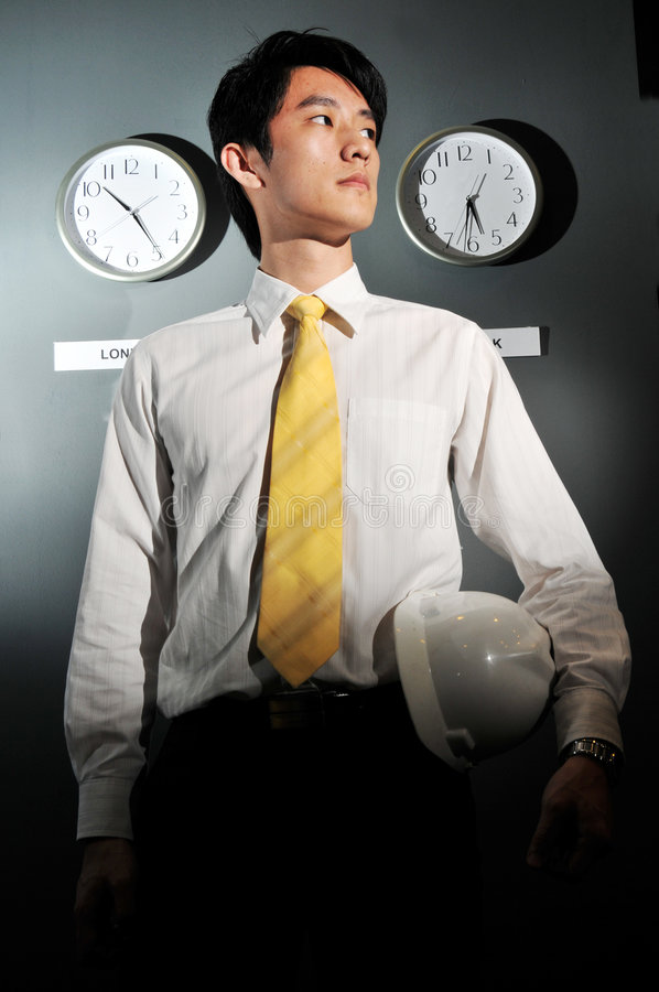 Asian Male Engineer concerned about time stock images