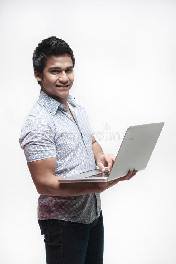 Asian Male holding a laptop royalty free stock photo