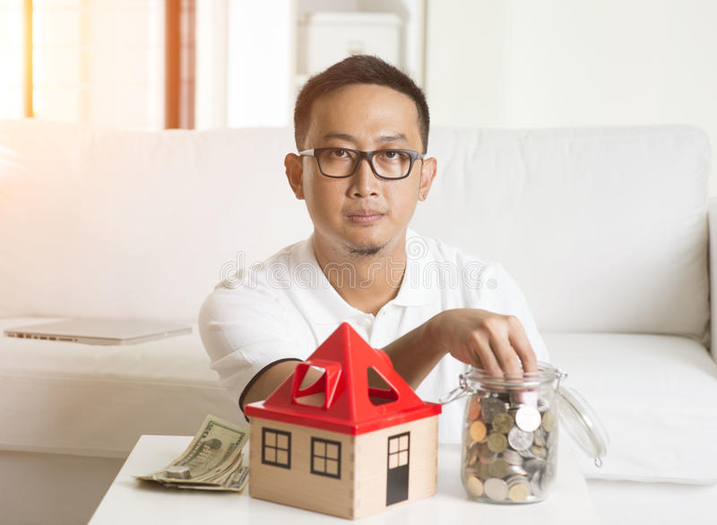 Asian male house loan stock photo