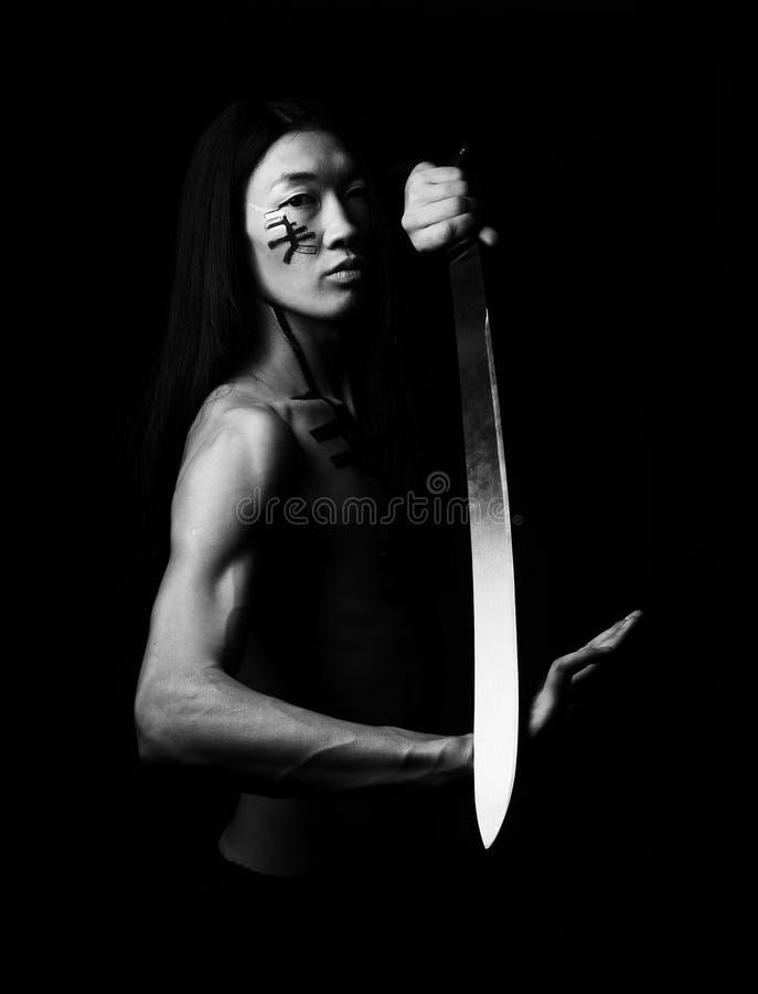 Asian man. Young asian man with katana stock photography