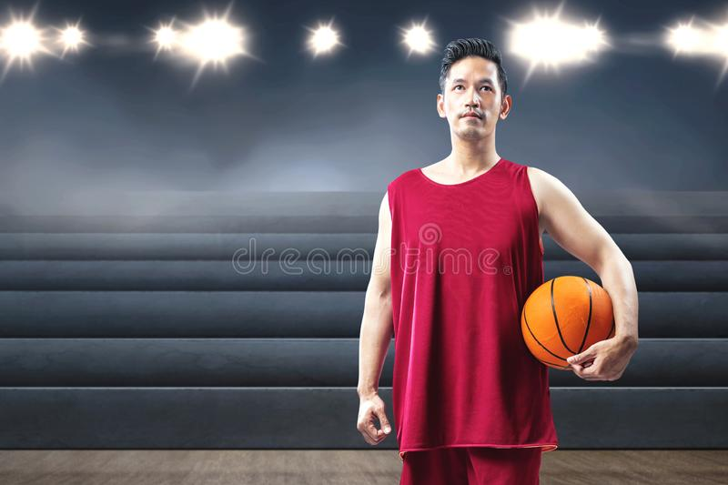 Asian man basketball player holding the ball on his hand stock image