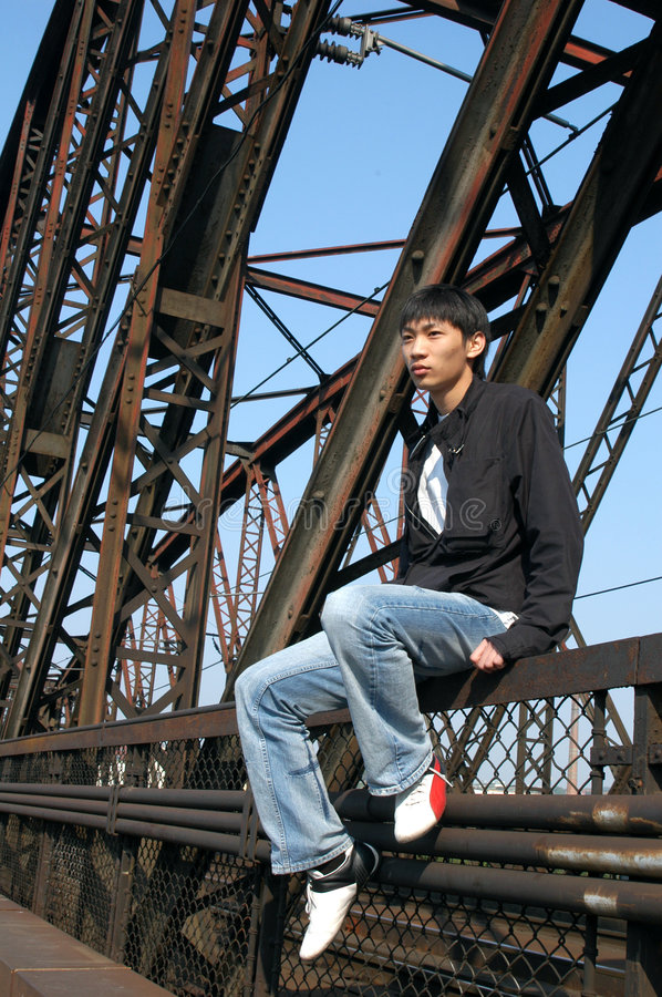 Asian Man on the Bridge stock photos