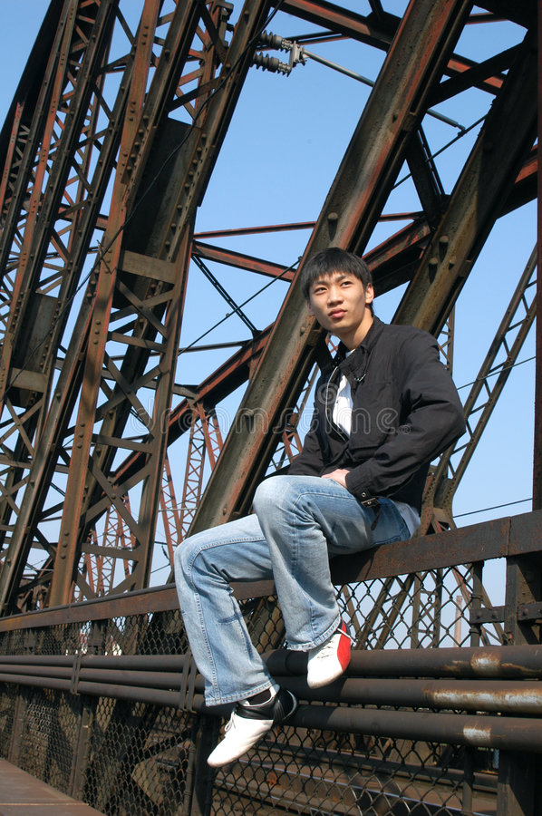 Asian Man on the Bridge stock photography