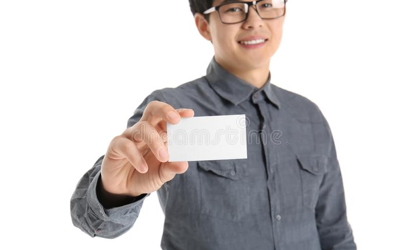 Asian man with business card on white background stock photo