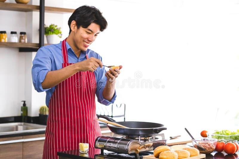 Asian man buttered on hamburger bread stock image
