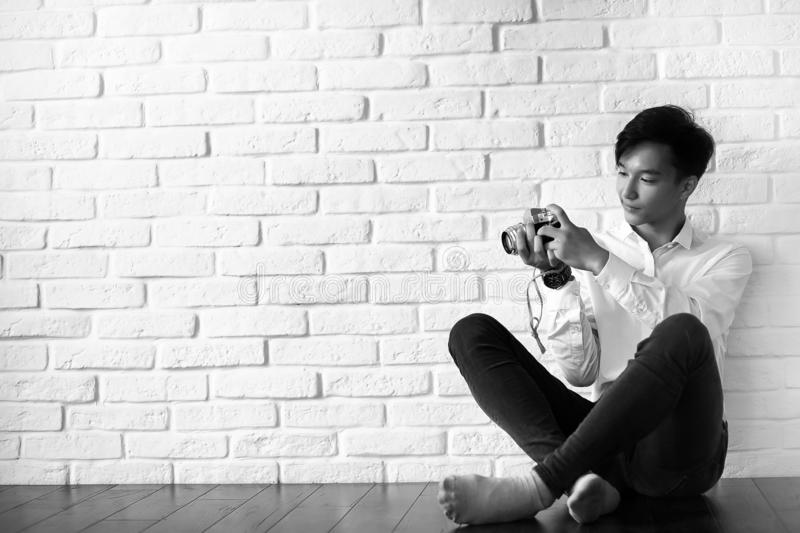 Asian man with a camera black and white stock images