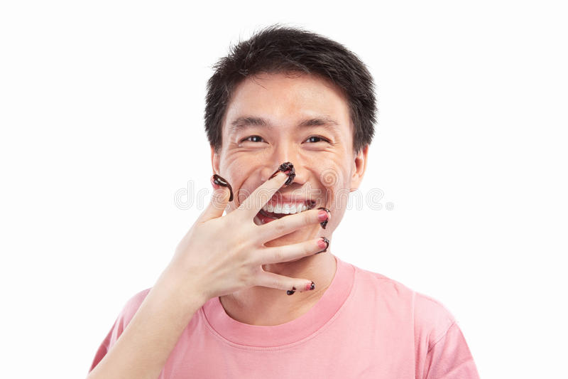 Asian man and chocolate spread. Chinese man which his face spread of chocolate, isolated on white background royalty free stock photos