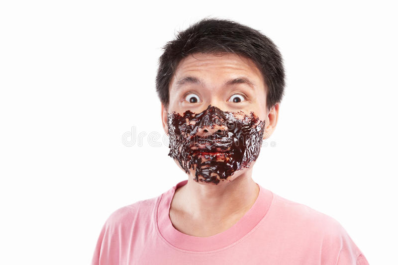 Asian man and chocolate spread. Chinese man which his face spread of chocolate, isolated on white background stock photo