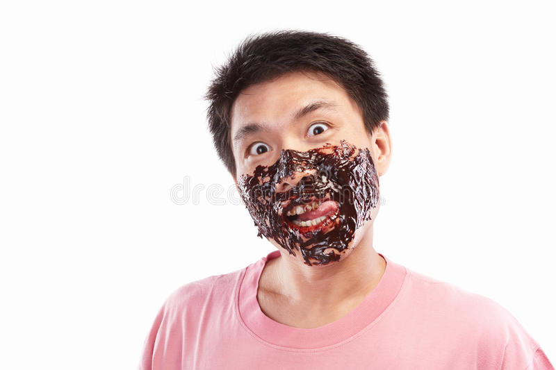 Asian man and chocolate spread. Chinese man which his face spread of chocolate, isolated on white background stock images