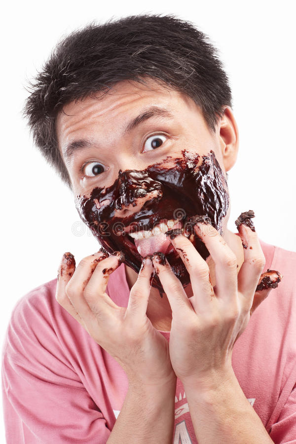 Asian man and chocolate spread. Chinese man which his face spread of chocolate, isolated on white background stock photography