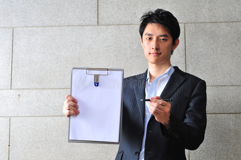 Download Asian Man With Clipboard Asking For Signature Stock Image - Image: 6265405