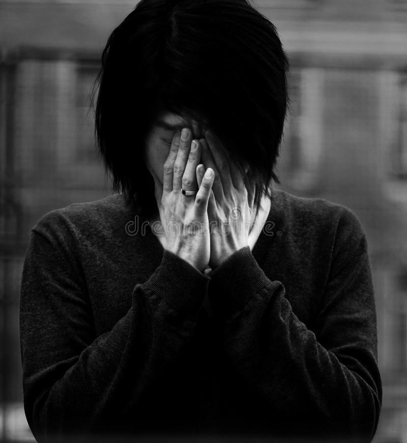 Asian man covered eyes with hands royalty free stock photos