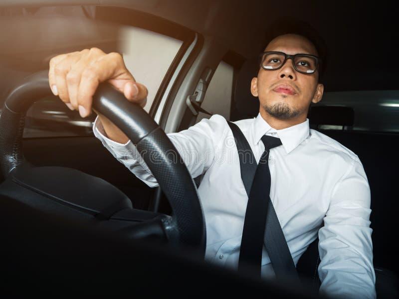 Asian man driving a car. stock photography