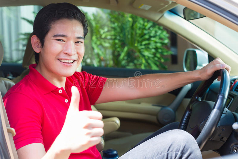 Asian man driving car royalty free stock photography