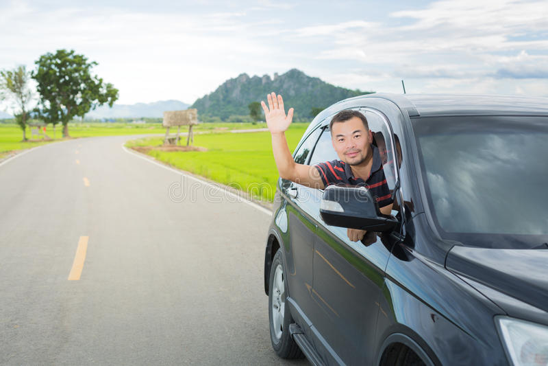 Asian man driving car stock photo