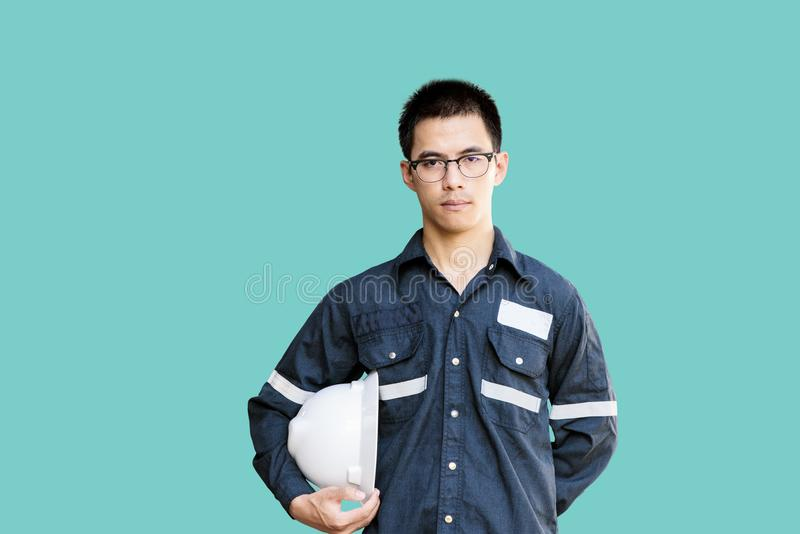 Asian man,Engineer or Technician in white helmet, glasses and bl stock images