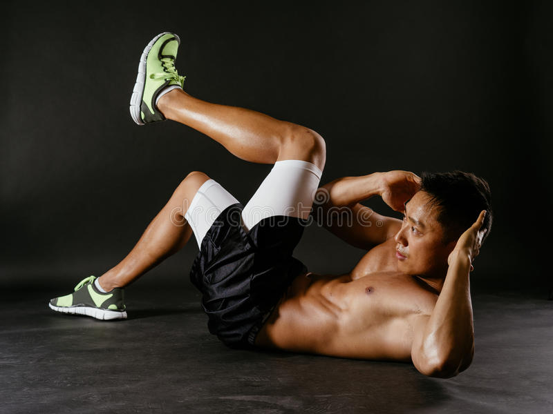 Download Asian Man Exercising His Stomach Muscles Stock Image - Image: 34269415
