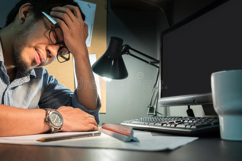 Asian man feeling exhausted. royalty free stock photography