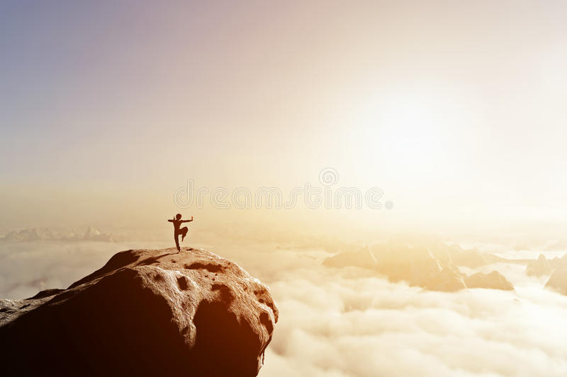 Asian man, fighter practices martial arts in mountains. Asian man, fighter practices martial arts in high mountains above clouds at sunset. Kung fu and karate royalty free illustration