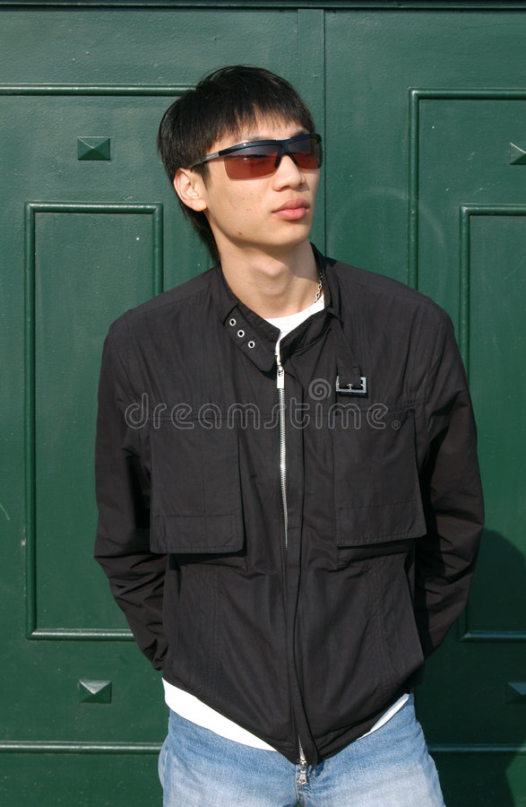 Asian Man in front of a Door stock image