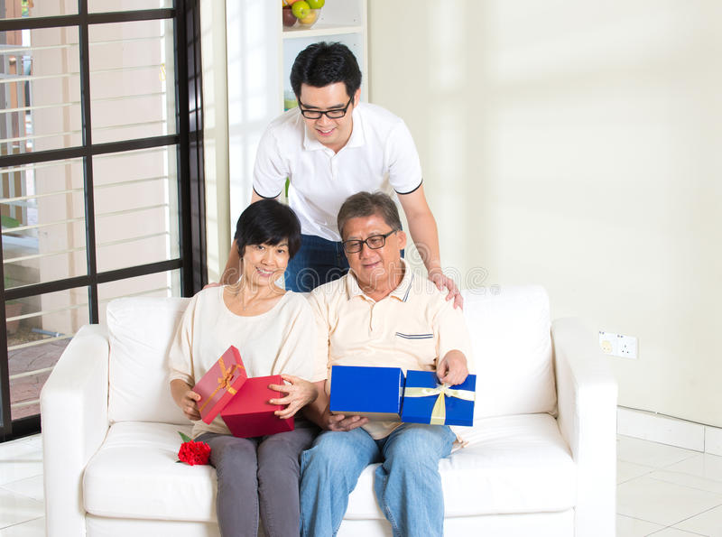 Asian man giving present royalty free stock photo