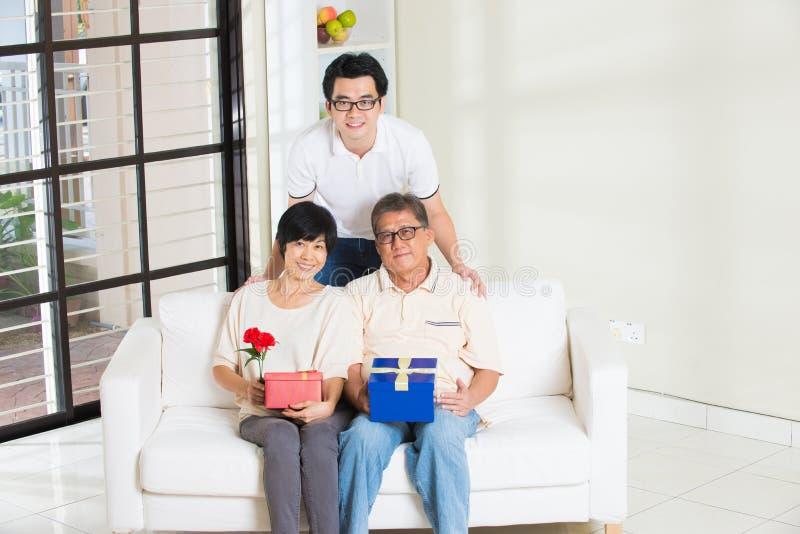 Asian man giving present stock photos