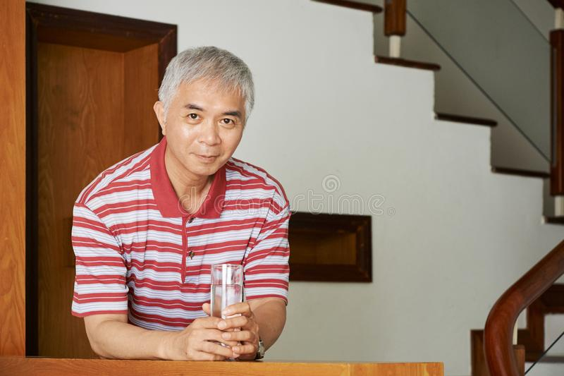 Asian man with glass of water royalty free stock photography