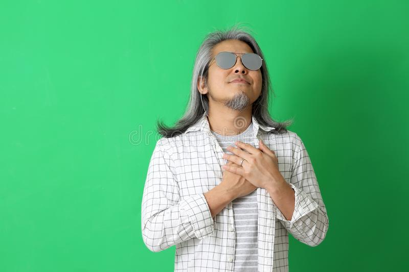Asian Man. The Asian man on the green background royalty free stock photography