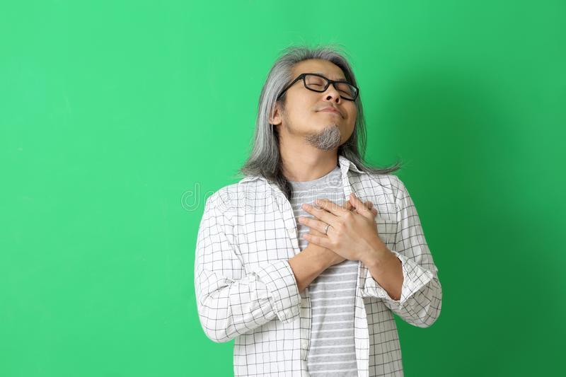 Asian Man. The Asian man on the green background stock photo