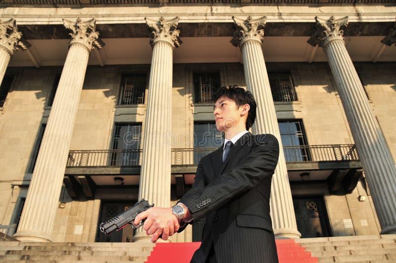 Asian Man With A Gun 2 Royalty Free Stock Photos
