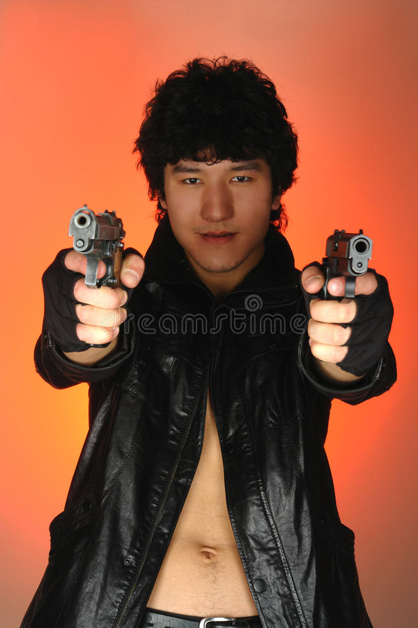 Asian man with guns. In hands stock photo